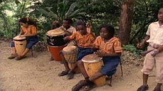 children are in Jamaica and they play bongo drums. Sesame Street Let's Make Music