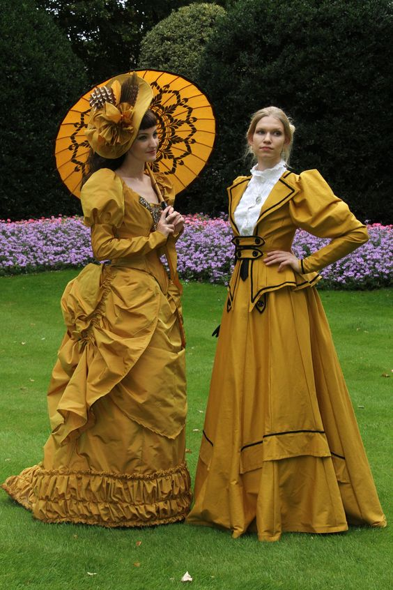 Women's Victorian/Belle Epoque fashion in gold/yellow. Hat, parasol, skirt, jacket, dress.