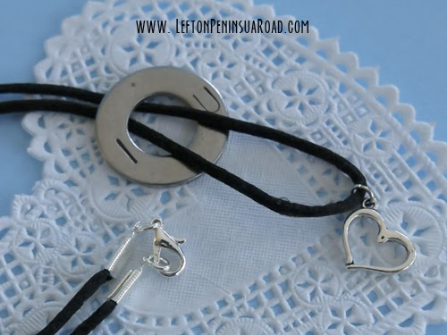 Stamped washer and heart charm are strung on black silk cord to make a Valentine's Day necklace.