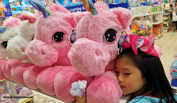 give kids what they want - parenting - Bacolod blogger - Bacolod mommy blogger - caroling - spoiling kids - spoiled kids - Christmas - talking with kids - toys - buying toys - Christmas - Toys R Us - pink unicorn stuffed toy
