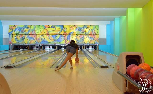 woman playing bowling