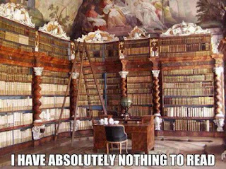 """Lots of enormous bookcases. """"I HAVE ABSOLUTELY NOTHING TO READ"""""""