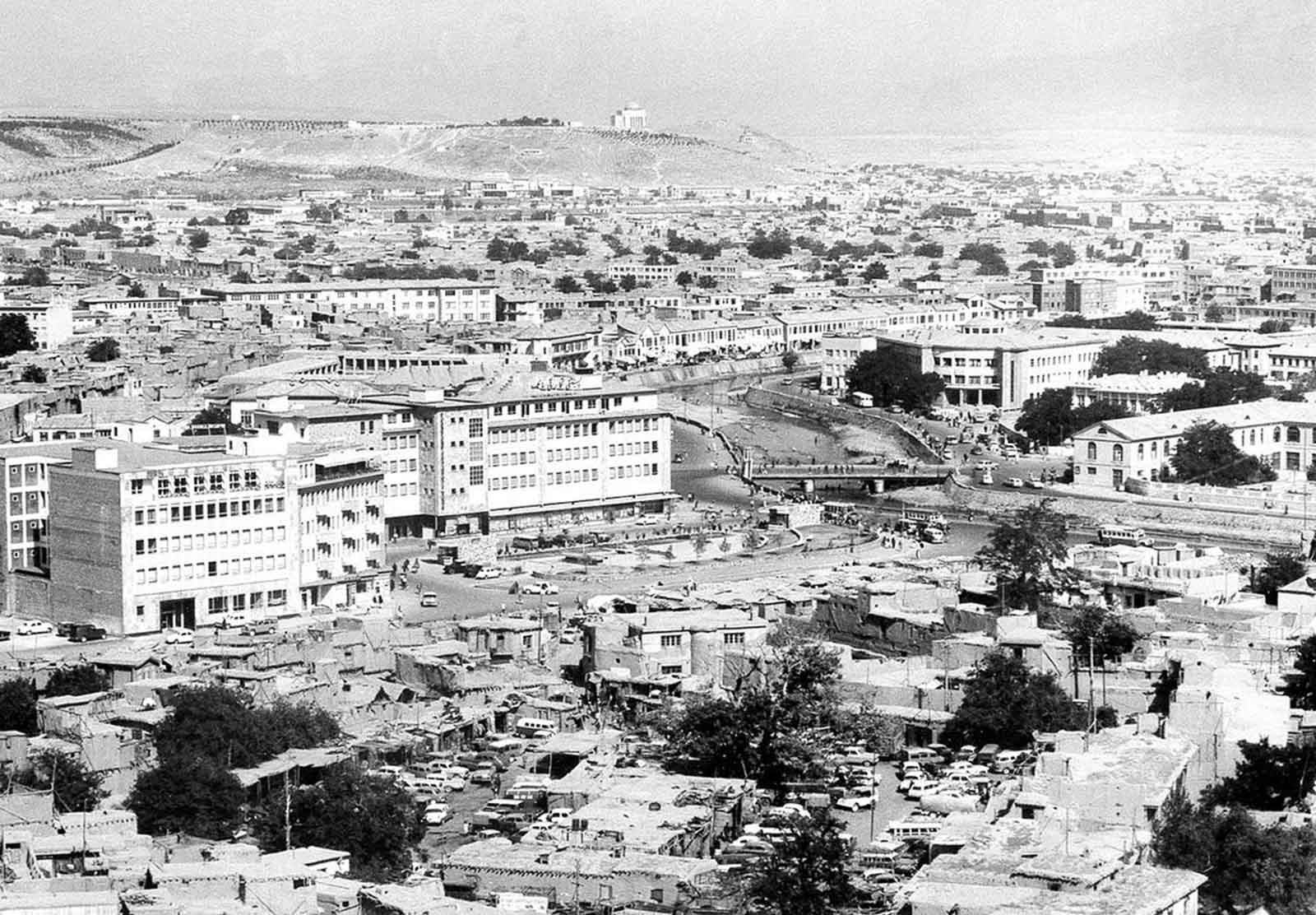A panoramic view showing the old and new buildings in Kabul, in August of 1969. The Kabul River flows through the city, center right. In the background on the hilltop is the mausoleum of late King Mohammad Nadir Shah.