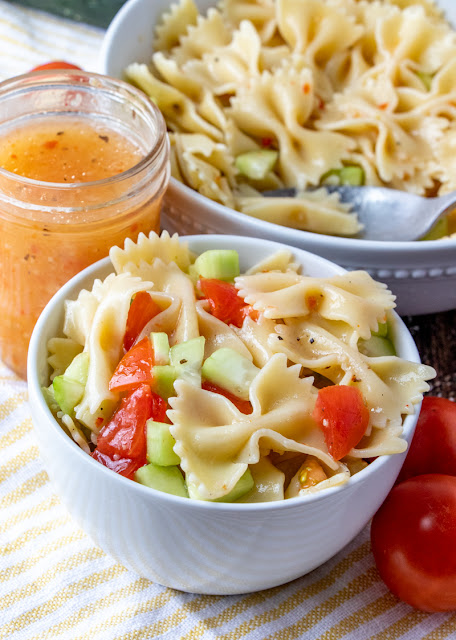 Pasta salad in a small and large bowl