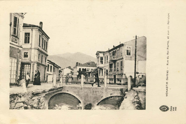 """Street King Peter and view of Pelister"" is the title of this postcard from 1917. Printed in: Photo D.A.Languet, 250 Faubourg, Saint-Martin Paris. On the photo is seen the Stone Bridge on River Kurdeles and the street Solunska on both sides of the river. River Kurdeles in 1975/76 was covered, thereby the street Solunska adjusted for traffic."