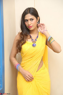 Nishigandha in Yellow backless Strapless Choli and Half Saree Spicy Pics 139.JPG