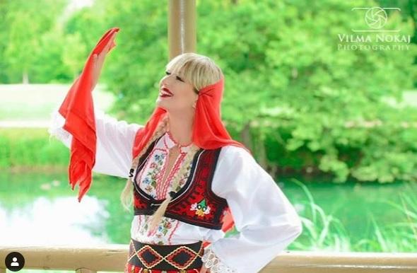 irina jovanka posing in albanian traditional vest