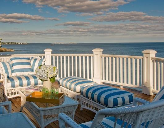 Coastal Porch with White Wicker Furniture