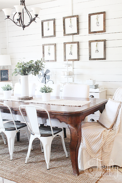 Summer decor and decorating ideas for dining room. Cottage farmhouse decor. White and neutral dining room. Gallery wall in dining room ideas