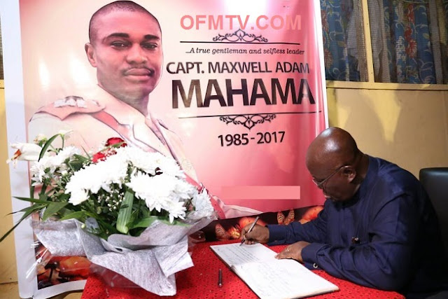 President Akufo-Addo signing the book of condolence in honour of Major Maxwell Adam Mahama