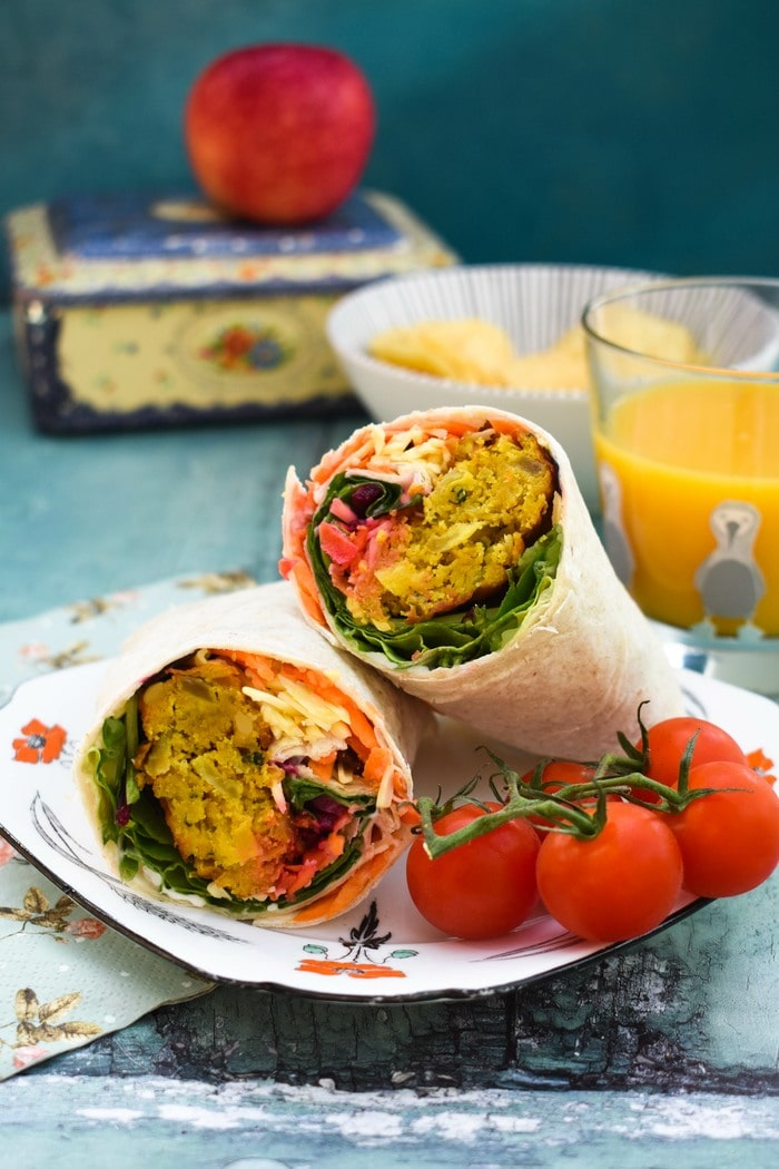 Onion Bhaji Lunch Wrap served with cherry tomatoes, crisps and an apple