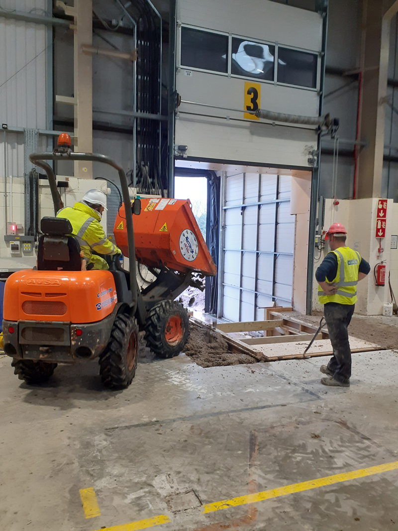Filling in the floor with concrete, in preparation for new dock levellers at Garador