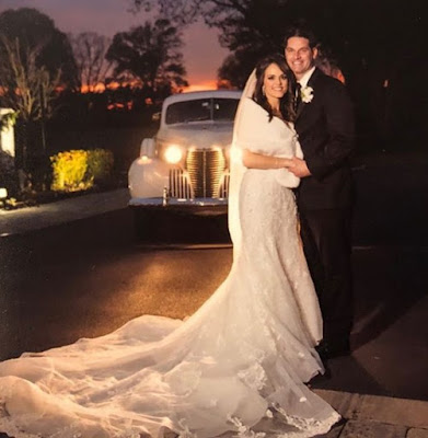 Andrea Grymes with her husband Gary in their wedding dress