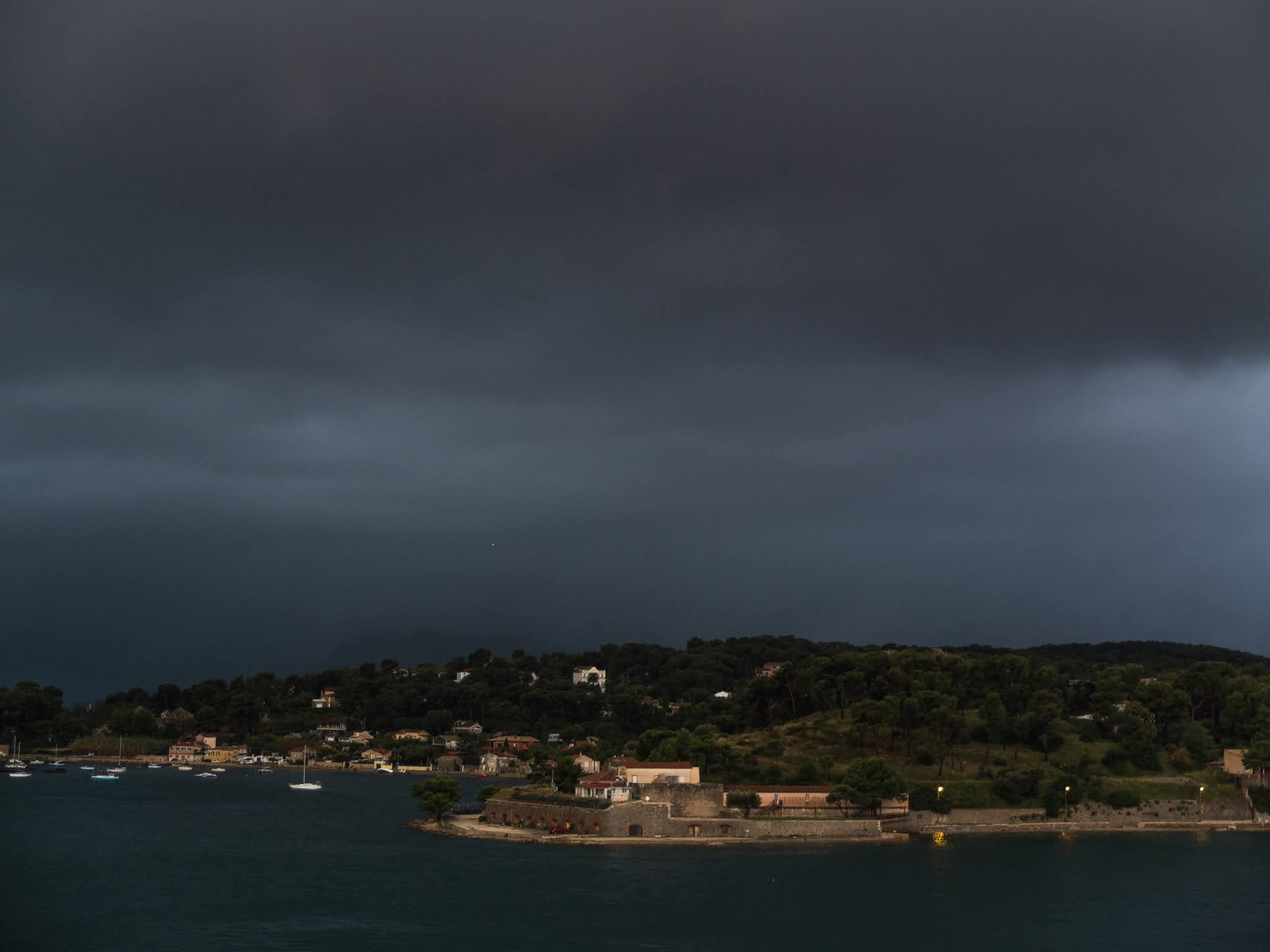 Early morning dark clouds in the Port of Toulon.