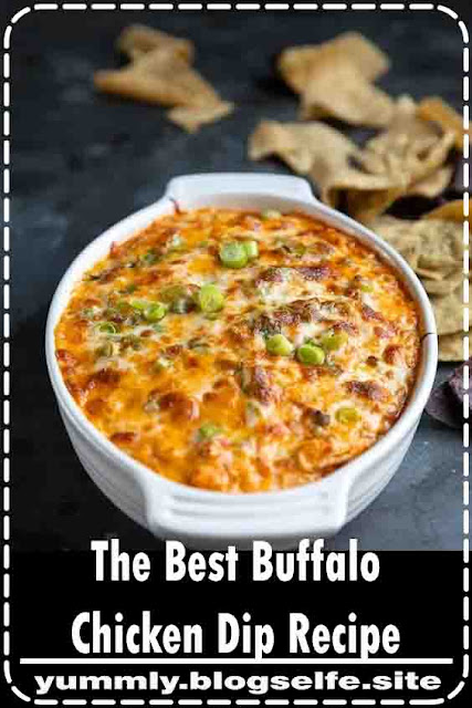 This Buffalo Chicken Dip Recipe is everyone's favorite game day or party appetizer! Made with juicy shredded chicken, creamy ranch dressing, cream cheese, hot sauce, and loads of cheese, this easy and delicious Buffalo Chicken Dip is then baked until golden, bubbly, and perfect for dipping.