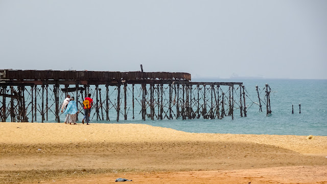 Musicians walking in Lome Beach