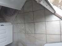 Porcelain tile repair. This repair was  made due to a subpump repair that was needed.
