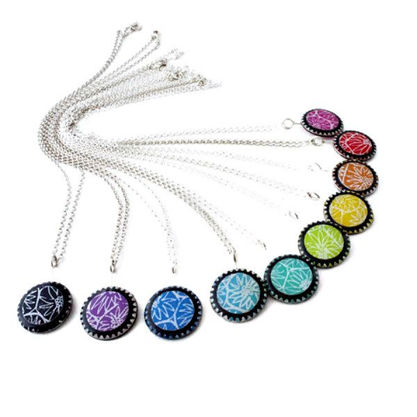 arrangement of rainbow colored necklaces made of printed paper and resin on sterling chains