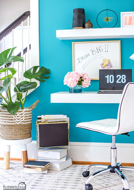 Teal, white and pink girl office with floating shelves