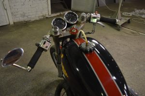 the gas tank and clip-ons installed on the Dnepr MT cafe racer