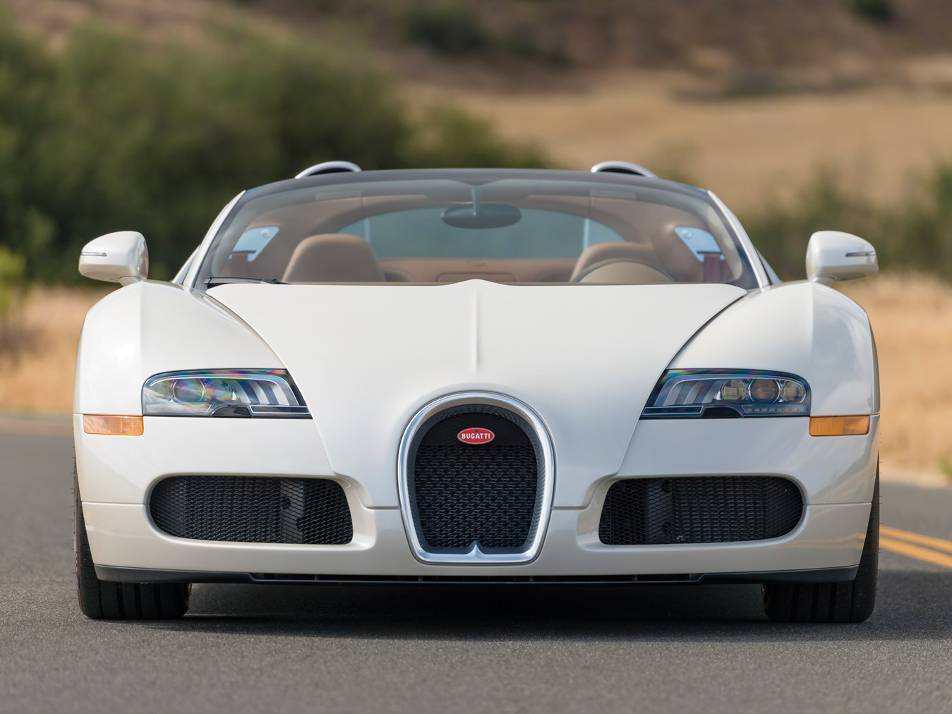 sleek all white bugatti veyron grand sport en route to auction. Black Bedroom Furniture Sets. Home Design Ideas