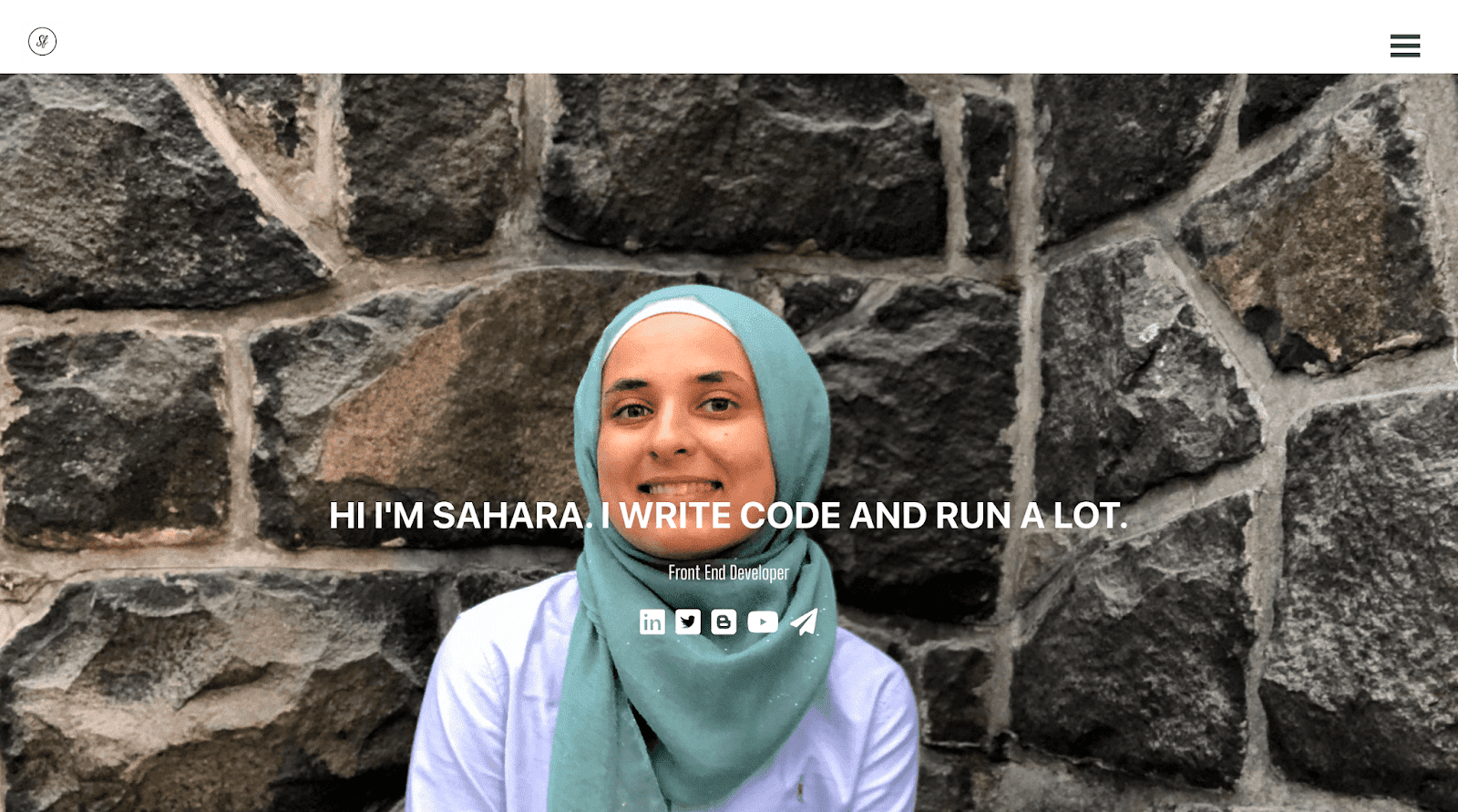home page of my portfolio - written on it it says: Hi I'm sahara. I write code and run a lot. Sub heading is 'Front End Developer' and below are my social media links