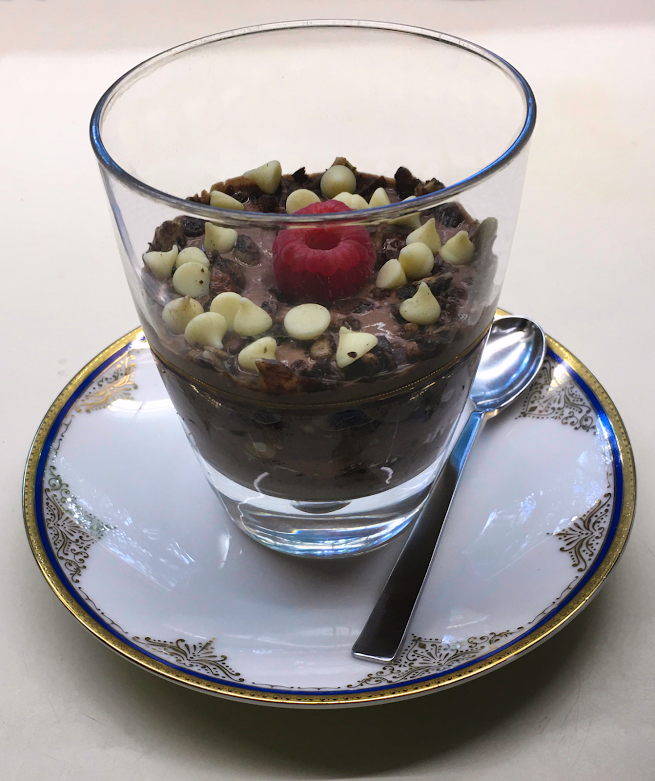 Photo of prepared keto chocolate yogurt granola chip parfait recipe, served in a small glass
