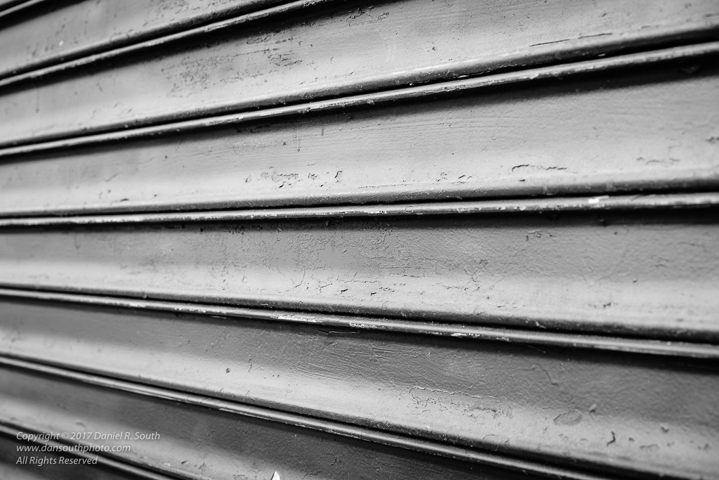 an abstract photo of a metal gate from an oblique angle in new york