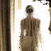 Αυτή η νύφη κέντησε την ιστορία αγάπης της στο νυφικό της