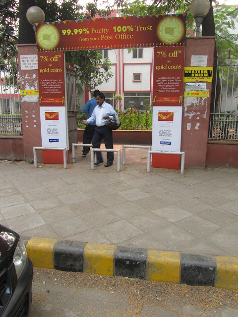 Photo showing decked up entrance with offers of 7% off on gold coins but access blocked by barriers