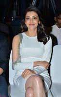 Beautiful Smiling Kajal Aggarwal in Creamy White Gown at MLA Telugu Movie Success Meet ~ .com Exclusive Pics 017.jpg