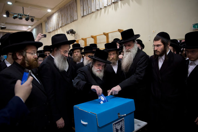 Image Attribute: Rabbi Israel Hager votes for Israel's parliamentary election at a polling station in Bnei Brak, Israel, Tuesday, April 9, 2019. Source: Oded Balilty/AP Photo