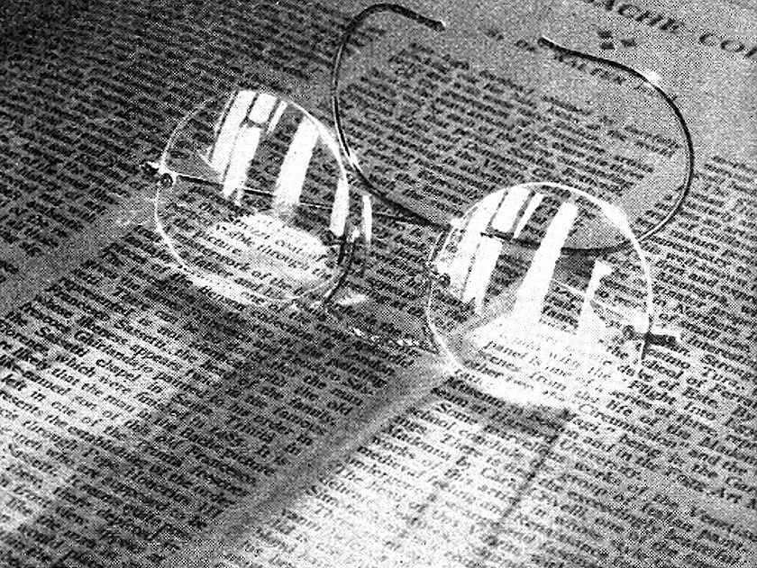 A old photograph of glasses on a newspaper