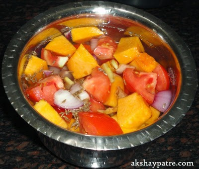 Add water to the pumpkin and vegetables preparing pumpkin soup recipe