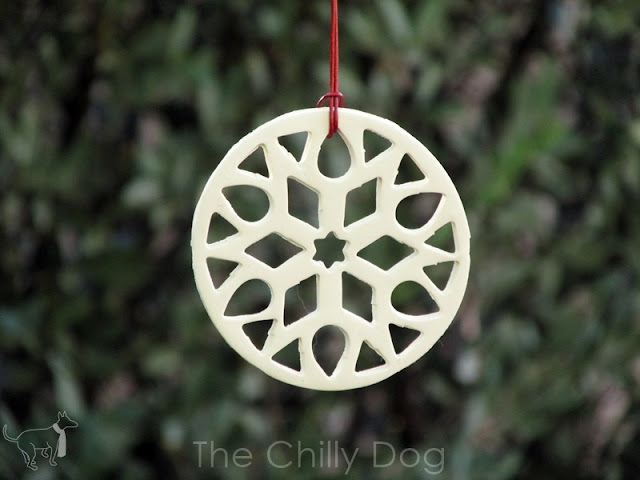 Make it a white Christmas with DIY clay snowflake ornaments.