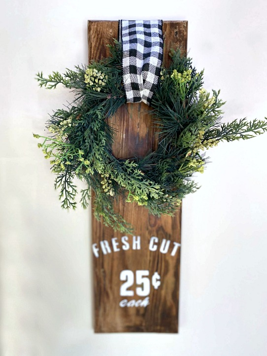 Wreath hanging on reclaimed wood with Fresh Cut stencil