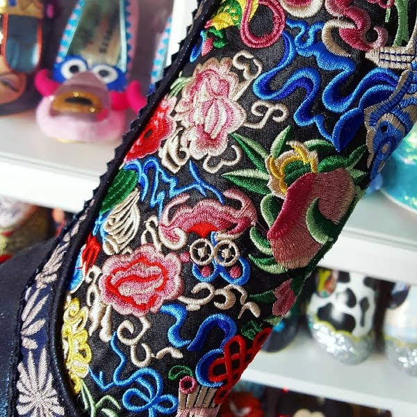 close up of bright floral embroidery on front of boot shaft