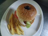 Burger bun and vegetables set by olive and toothpick for veg burger recipe