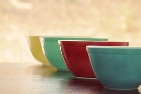 Yellow, green red and blue vintage pyrex bowls for cooking