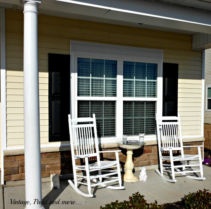a southern porch with white wood rockers