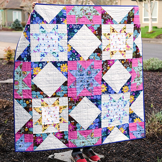 Dilly Dahlia Giant Block Quilt designed by Erica Taylor Jackman of Kitchen Table Quilting