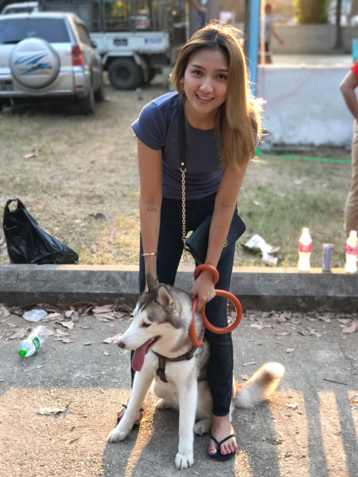 M Seng Lu and Her Pet Husky Dog Playing At The Park