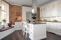 Scandinavian kitchen ideas with brick wall and white backsplash tiles