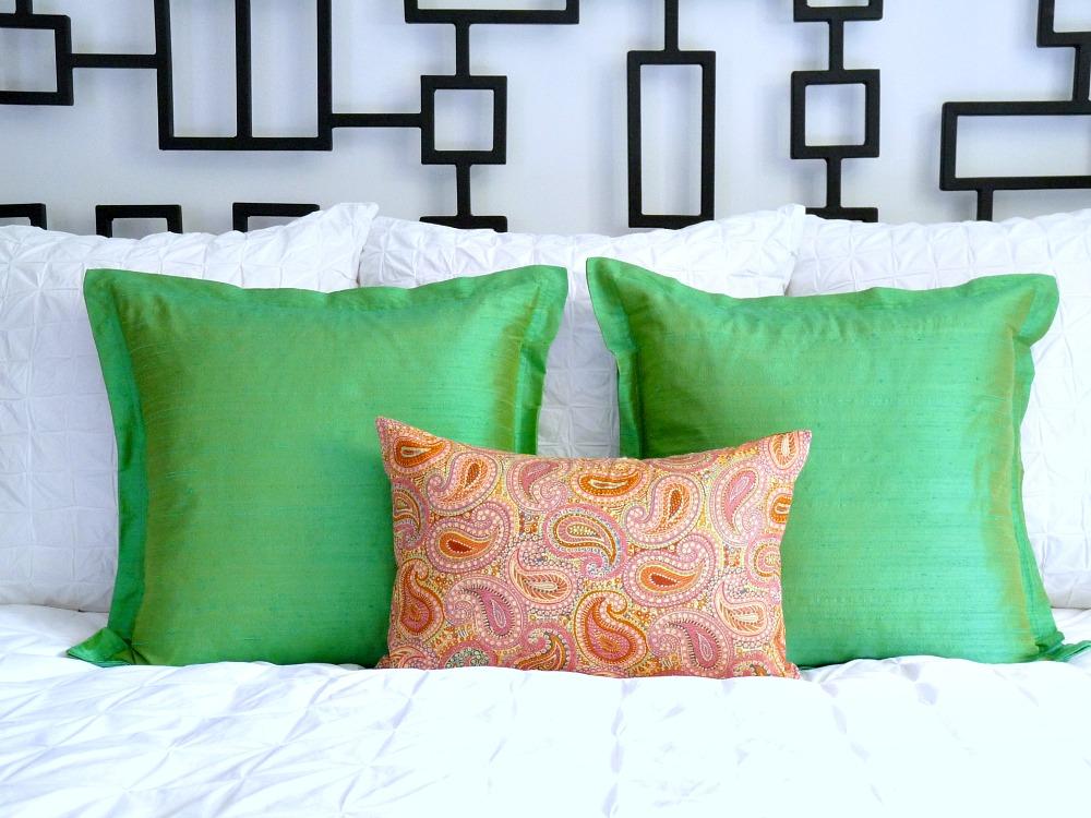 Green silk and orange paisley pillows