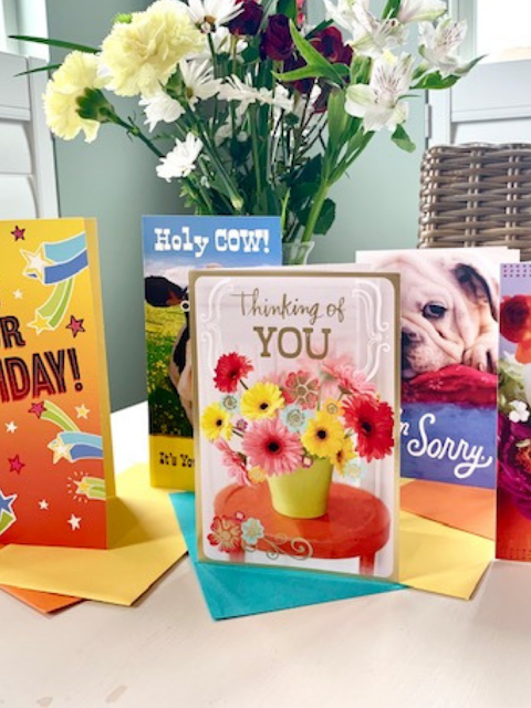 greeting cards and a bouquet of flowers