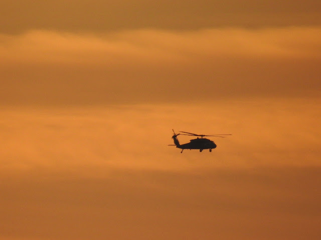 A helicopter in sunset