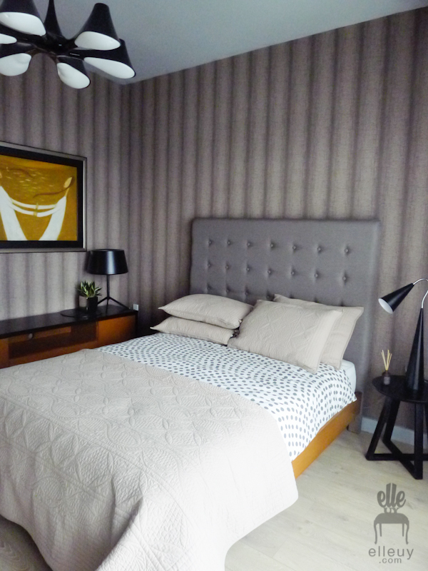 modern hotel inspired mcm bedroom with brown wall paper and gray headboard