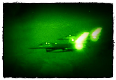 F-16's viewed from a tanker through night vision goggles.