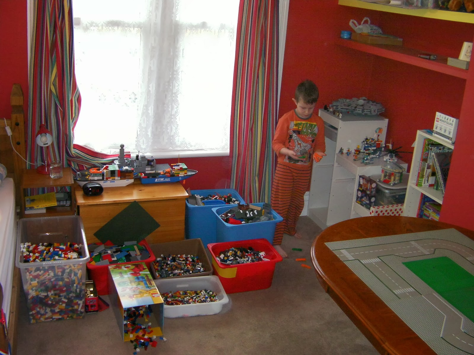 lego sorted into boxes of bricks and shapes with roadway glued to table