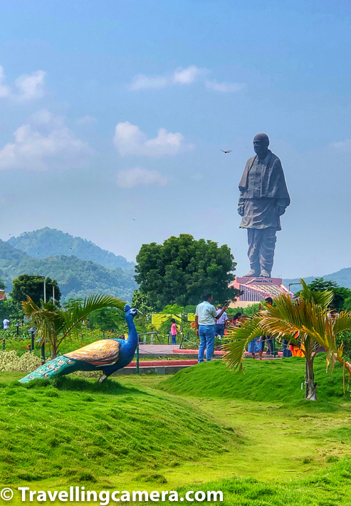 Valley of Flowers around Statue of Unity in Gujrat is curated pretty well with variety of flowering plants as well as interesting installations like peacocks, tigers etc. Above photograph shows Peackcock installation in Valley of Flowers along with Statue of Unity in the background. The Statue if quite far from this park, while it looks very close in above photograph.